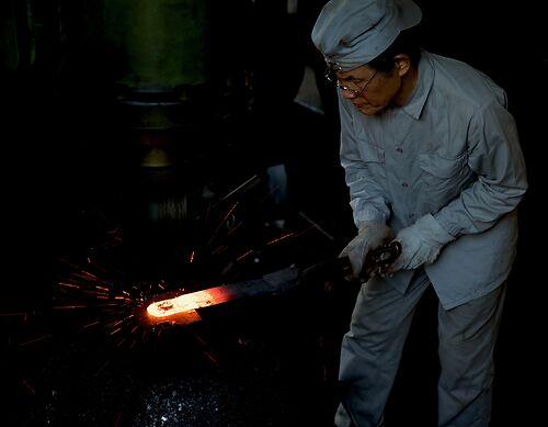 Hand laminating in the Tsunesaburo workshop